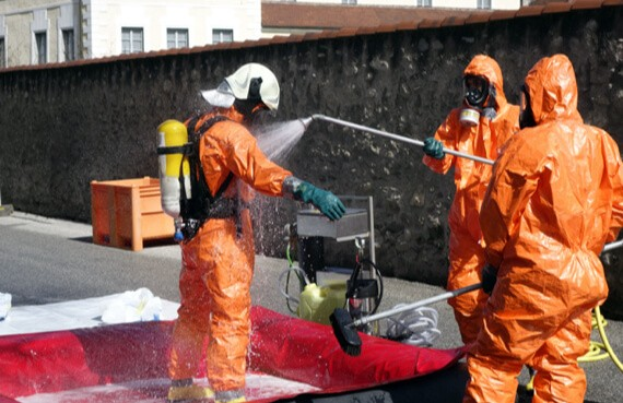First Response Cleaning's certified team of cleaners disinfects their hazmat suits